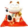 Tirelire chat porte bonheur sur coussin rouge